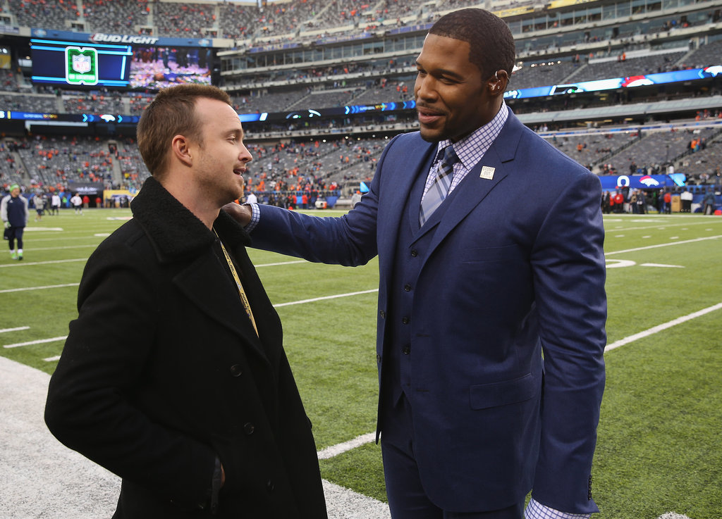 Michael Strahan greeted Aaron Paul at the Super Bowl.
