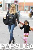 Heidi Klum walked hand in hand with her daughter Lou in LA on Sunday.