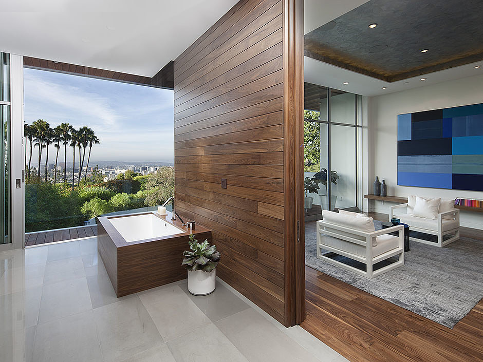 The bathtub is in an ideal position for soaking in sunset views.  Source: The Agency