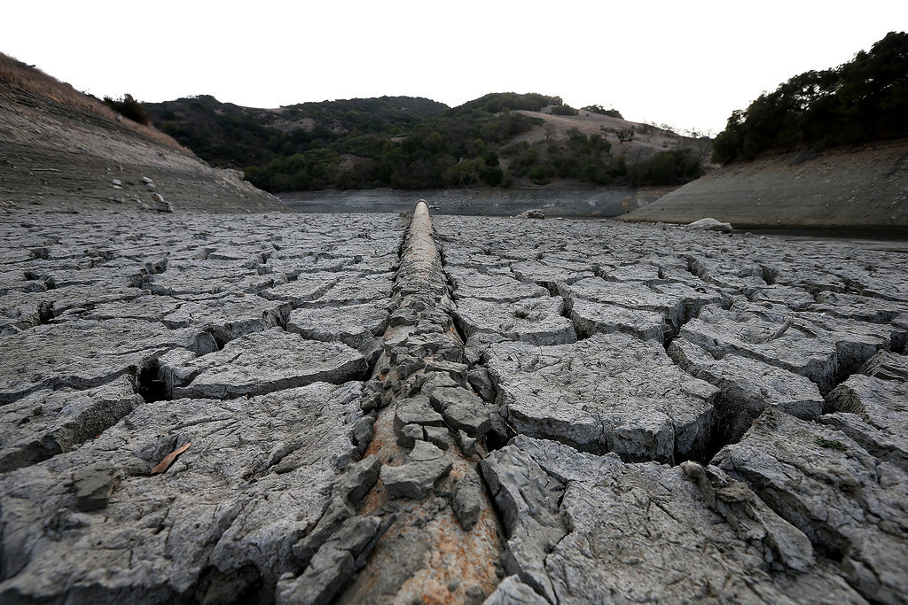 The ground is dry and cracked at the bottom of San Jose's Almaden Reservoir.