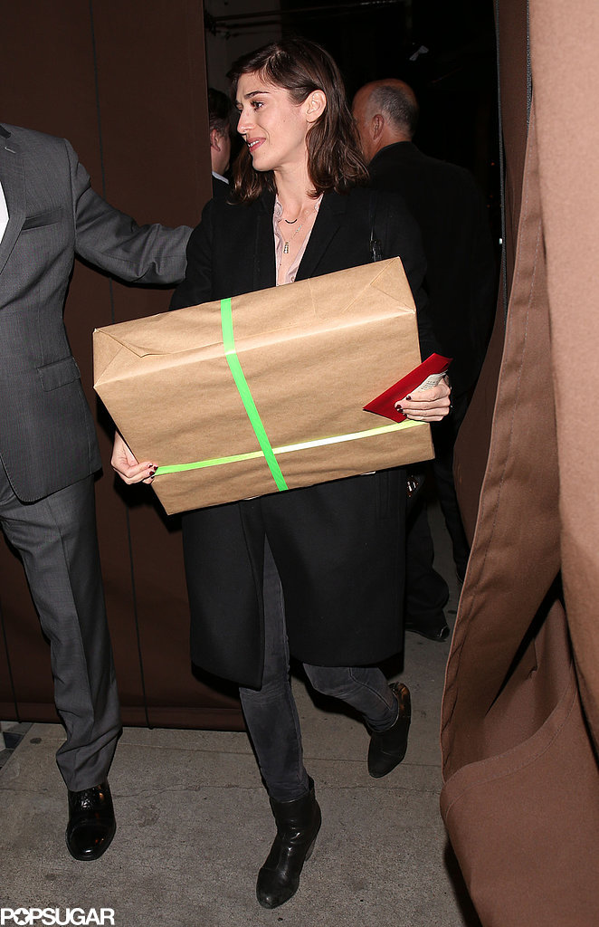 Michael's Masters of Sex costar Lizzy Caplan arrived with a big gift.