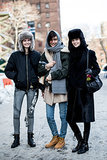 Models, they're just like us: just hanging with their friends and keeping warm in the snow.