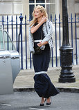 Poppy Delevingne showed off an elegant, long navy dress and a tweed jacket for the occasion.