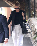 Gwyneth wore comfortable white pants.