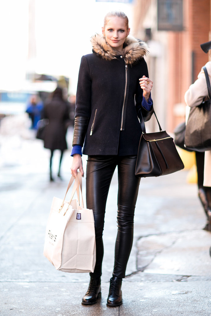 She stayed true to the model dress code with leather leggings and a touch of fur.