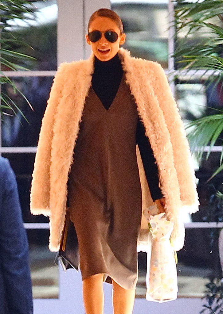 Nicole donned a large coat.