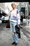 We're taking a trip to the '90s, thanks to her acid-wash jeans.