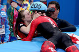 Canada's Charles Hamelin gave his teammate and girlfriend Marianne St-Gelais a big kiss after winning the gold medal in the short-track men's 1500m speed skating final.
