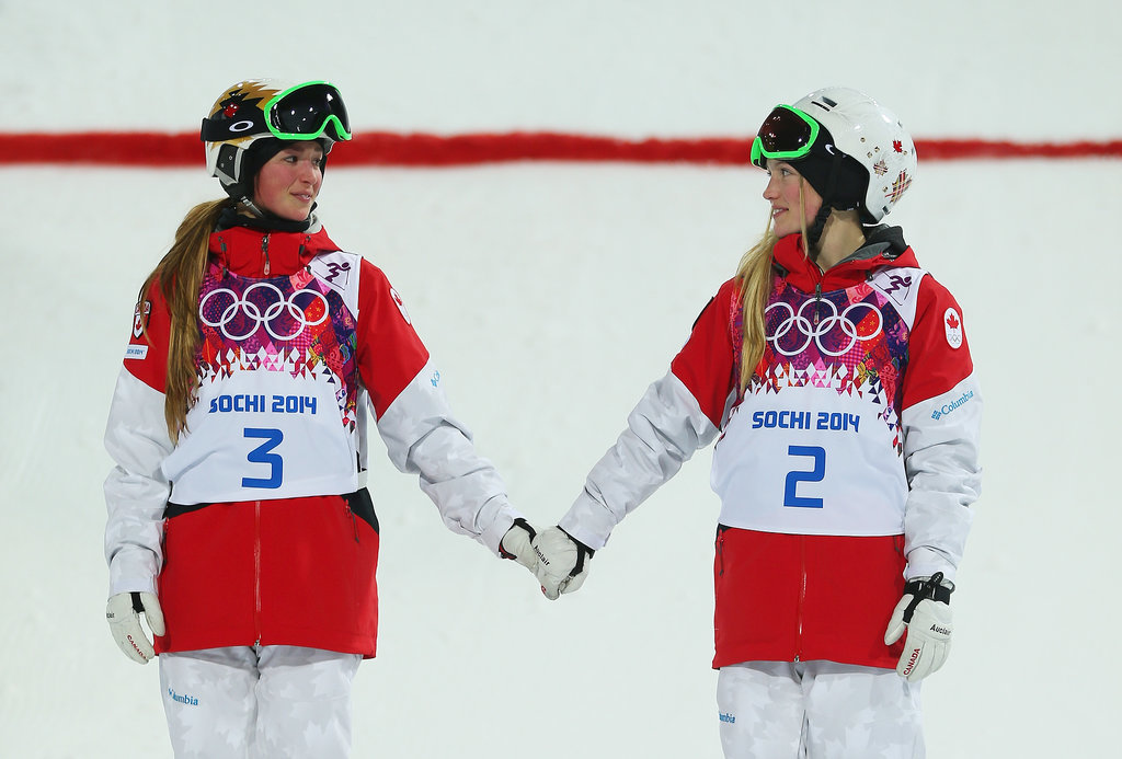 Canadian sisters Chloe and Justine Dufour-Lapointe held hands after earning the gold and silver medals in the freestyle skiing women's moguls finals.