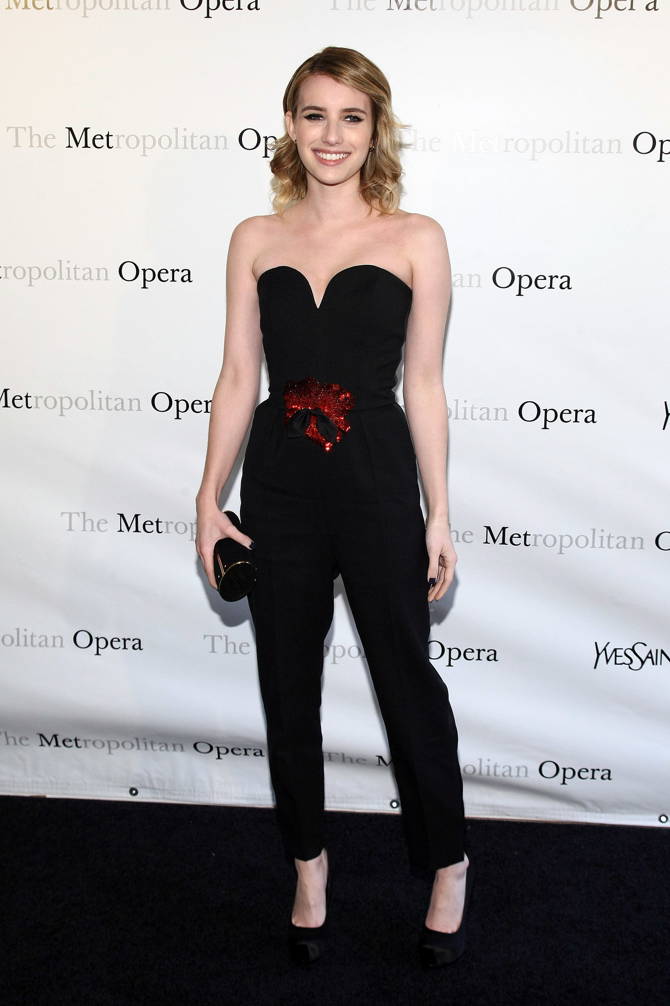 Emma wore a risk-taking black Yves Saint Laurent jumpsuit to a Metropolitan Opera premiere in March 2012.