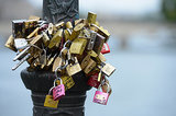Love locks are attached to Le Pont Des Arts in Paris.