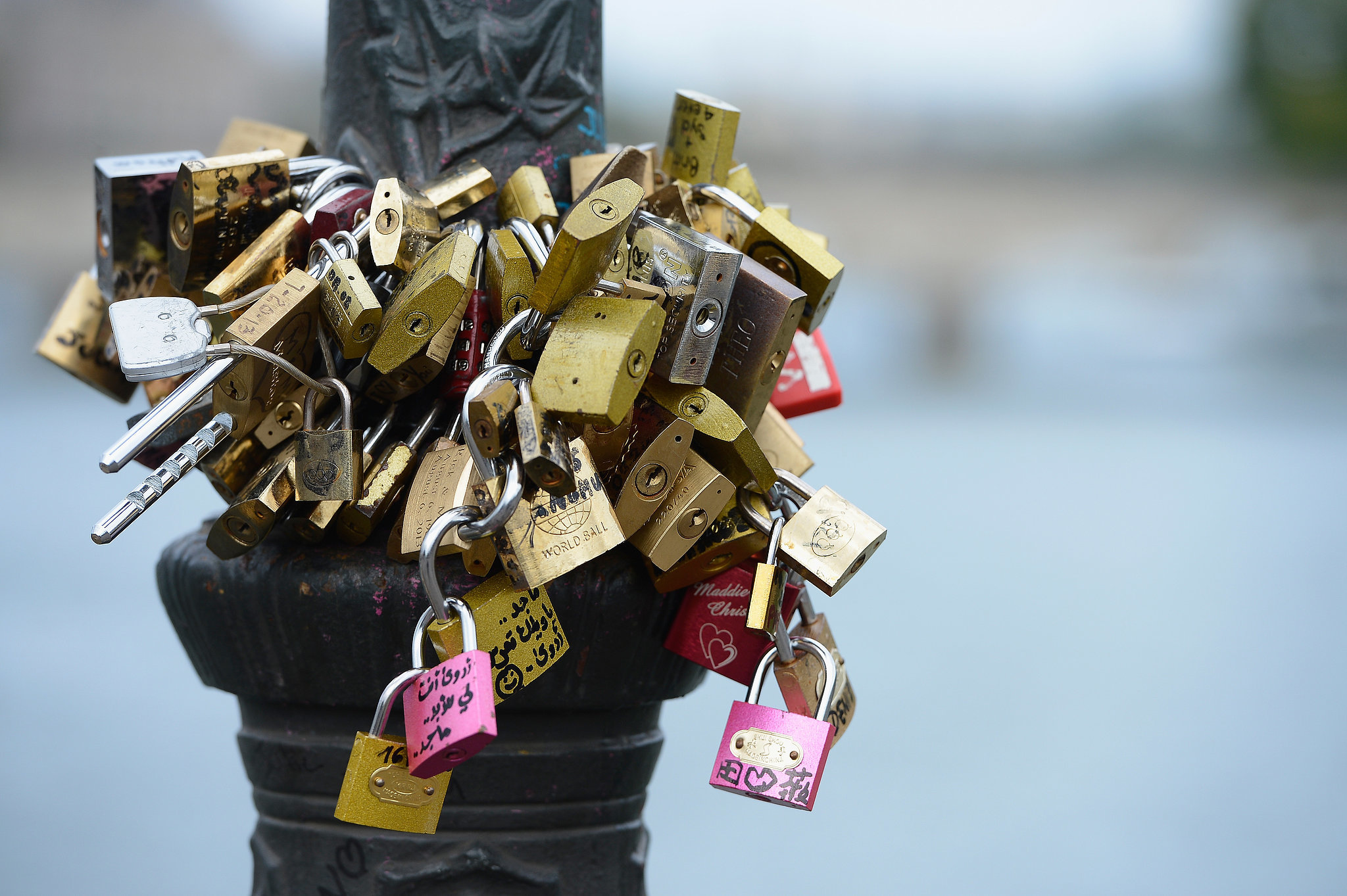 Love locks are attached to Le Pont Des Arts