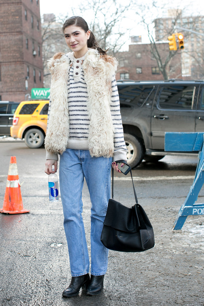 We'll never tire of a chic play like this — fur vest and staple stripes.