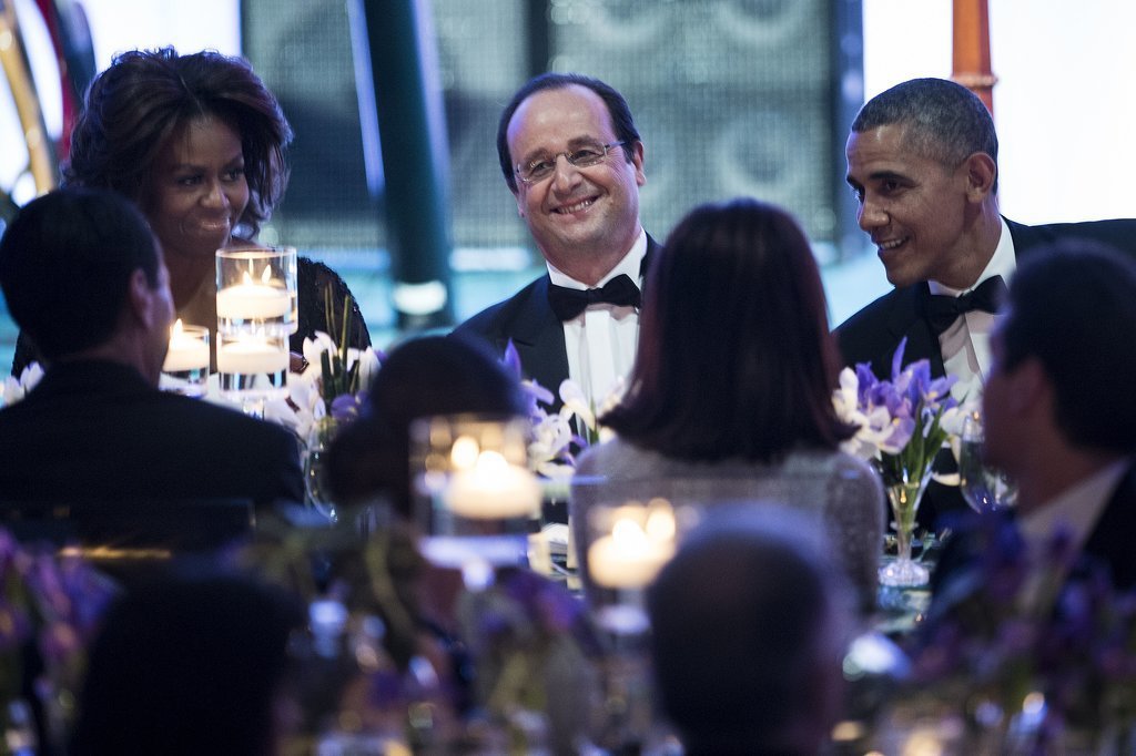 President Hollande took pride in his spot between his hosts.