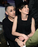 Anne Hathaway sat in Alan Cumming's lap.