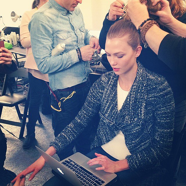 Karlie Kloss did some multitasking while in the hair-and-makeup chair during NYFW. Source: Instagram user karliekloss