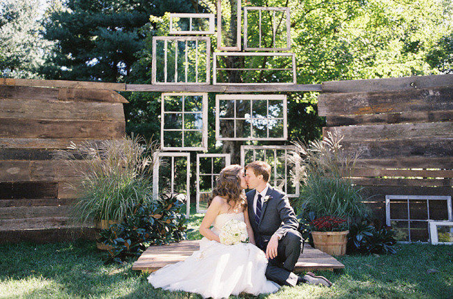 How unique! We love how this backdrop was made from several pieces of wood but gives off the illusion of hanging windows.  Photo by Leah McCormick of Photography by Leah via Style Me Pretty