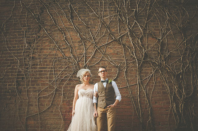 They're as simple as intertwined branches, but they add such a dramatic feel to the setting.   Photo by Alec Vanderboom via Green Wedding Shoes