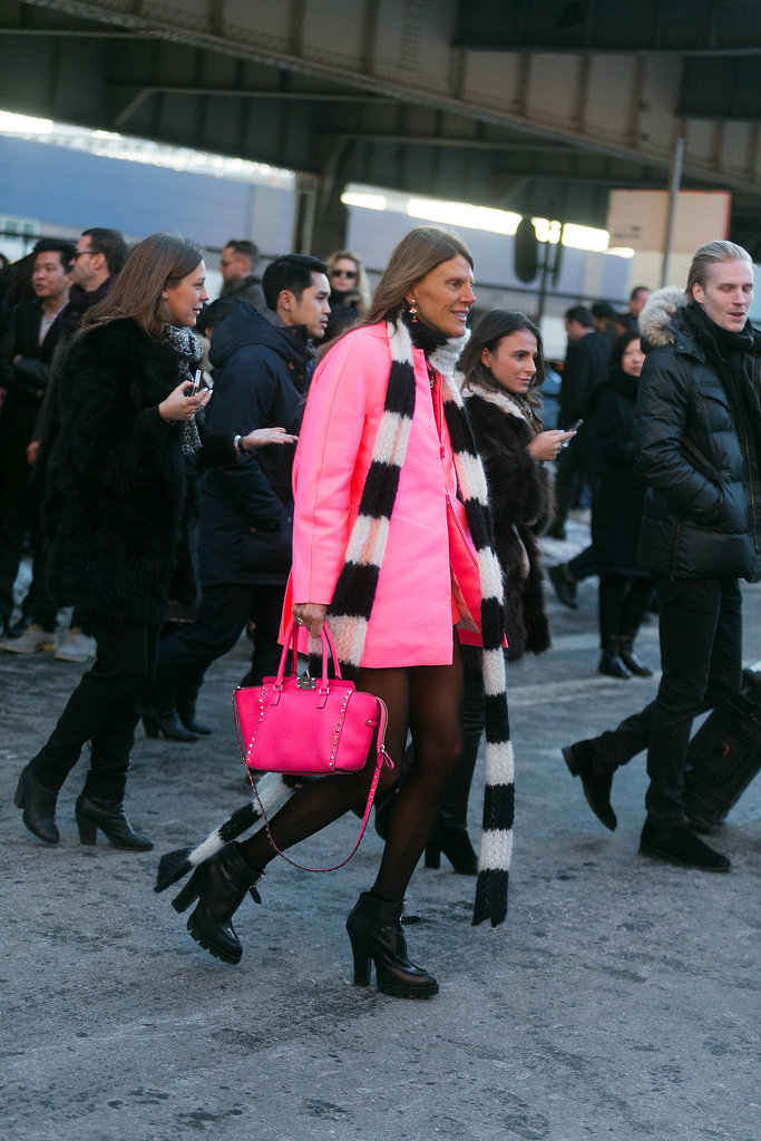 Just look at Anna Dello Russo's bubblegum-pink coat, and try not to smile.  Source: Melodie Jeng/The NYC Streets
