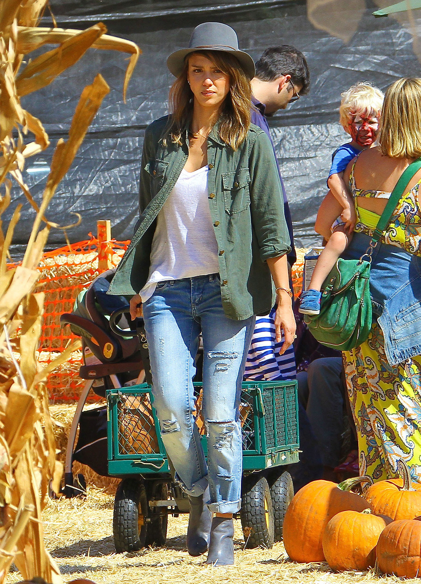 Cruising Mr. Bones Pumpkin Patch in ripped boyfriend jeans, The Perfect Shirt by Current/Elliott, and gray ankle boots.
