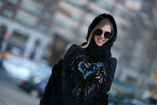 Chiara Ferragni accessorized with black shades and a cozy hood.
