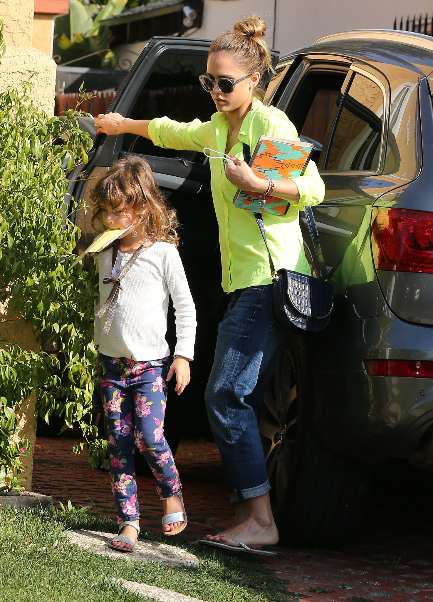 Jessica took on the neon trend in a lime-green button-down and cuffed Current/Elliott boyfriend jeans while taking daughter Honor to a playdate in West Hollywood.