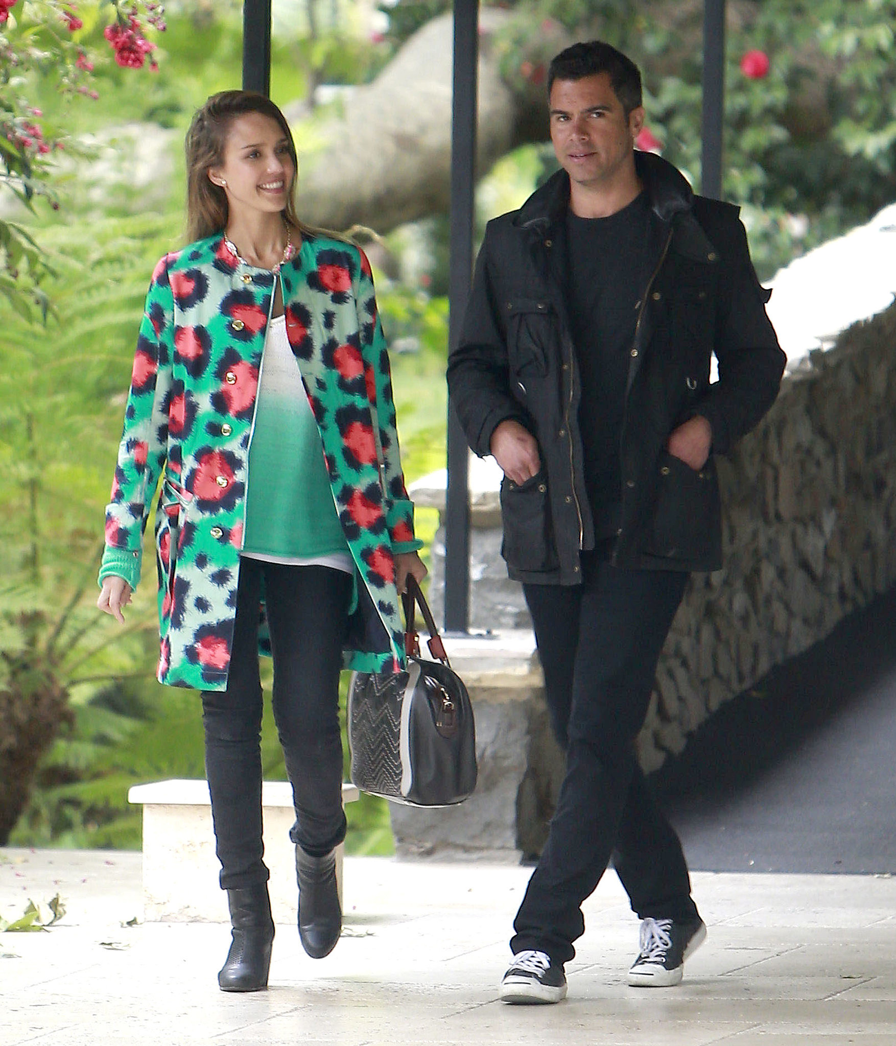 Jessica Alba brightened her washed black denim with a high-wattage Kenzo coat while attending Jessica Simpson's baby shower in Beverly Hills. Husband Cash looked just as cool in his monochrome look.