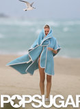 Candice Swanepoel Braves the Rain in a Bikini