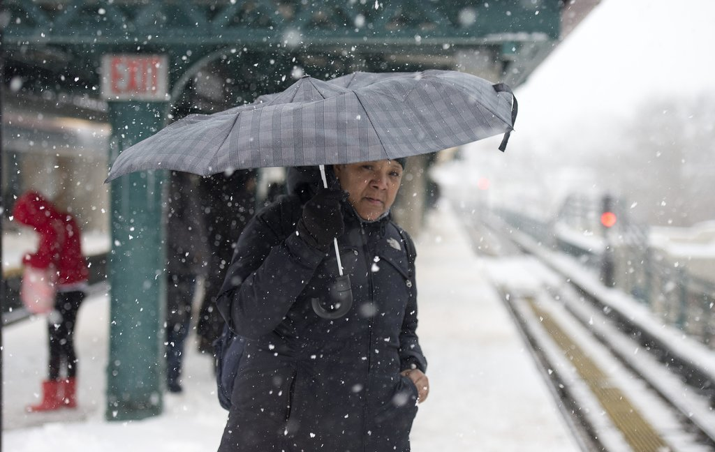 Commuters carried umbrellas to brave the NYC weather.