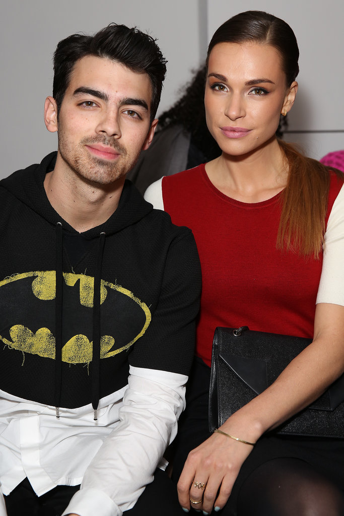 Joe Jonas showed his love for Batman at The Blonds fashion show with girlfriend Blanda Eggenschwiler on Wednesday.