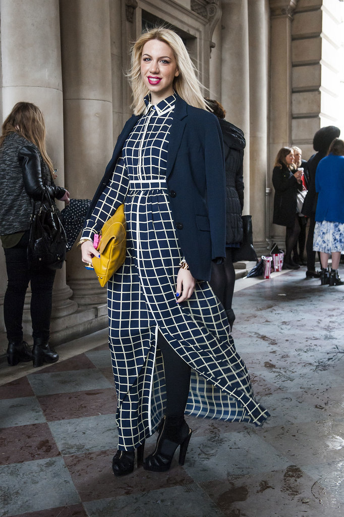A sheer windowpane-print number looked extra dramatic thanks to the wind! We also love the pop of colour from the buttercup-yellow bag.