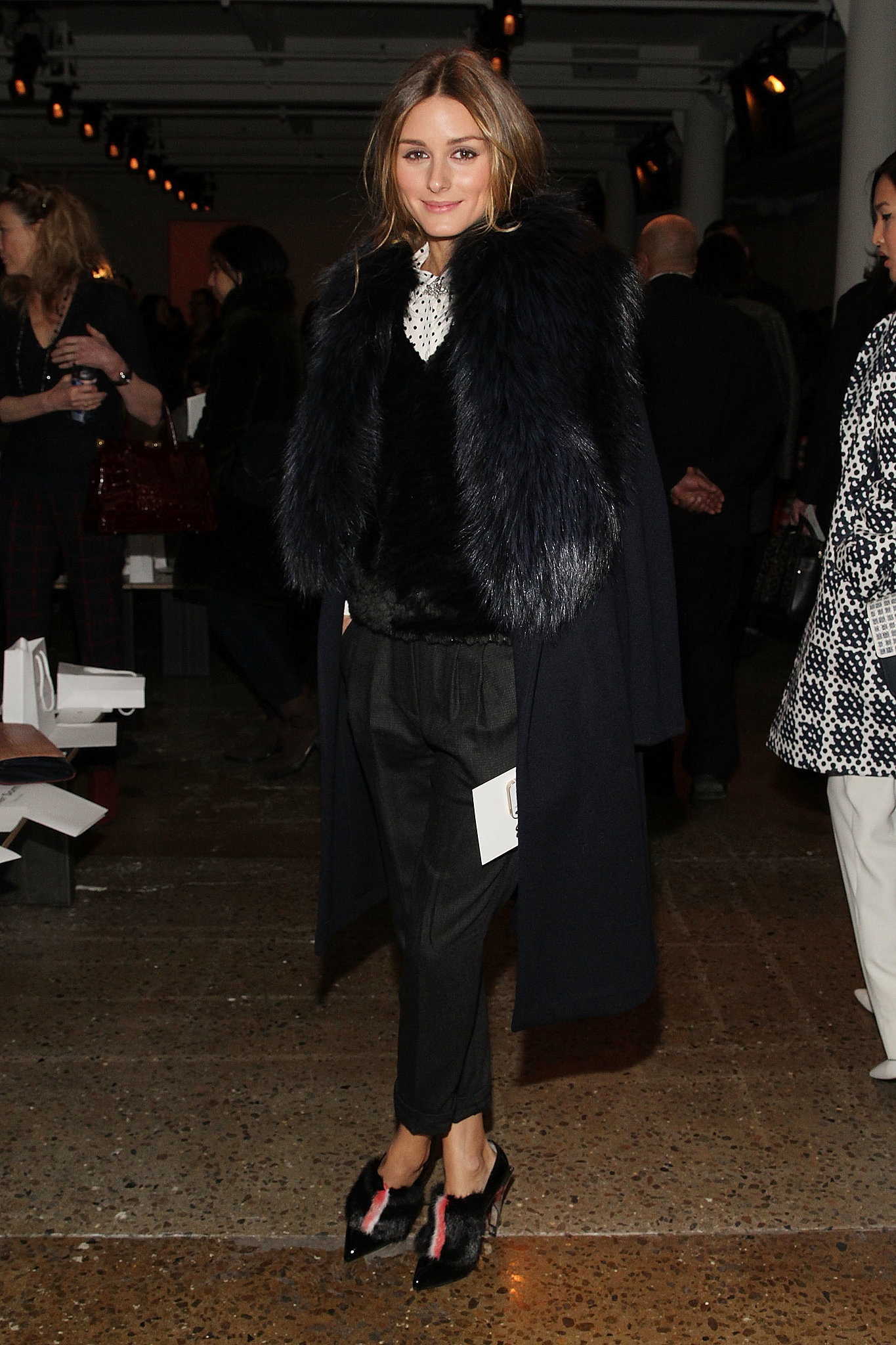 For Peter Som's front row, Olivia styled out a Club Monaco shirt and Tibi trousers with a covet-worthy pair of Fendi heels and a fur-collared Agnona coat.