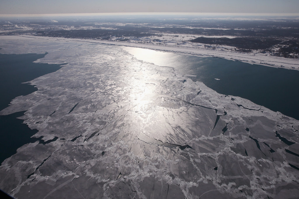 Ice can be seen covering Lake Michigan.