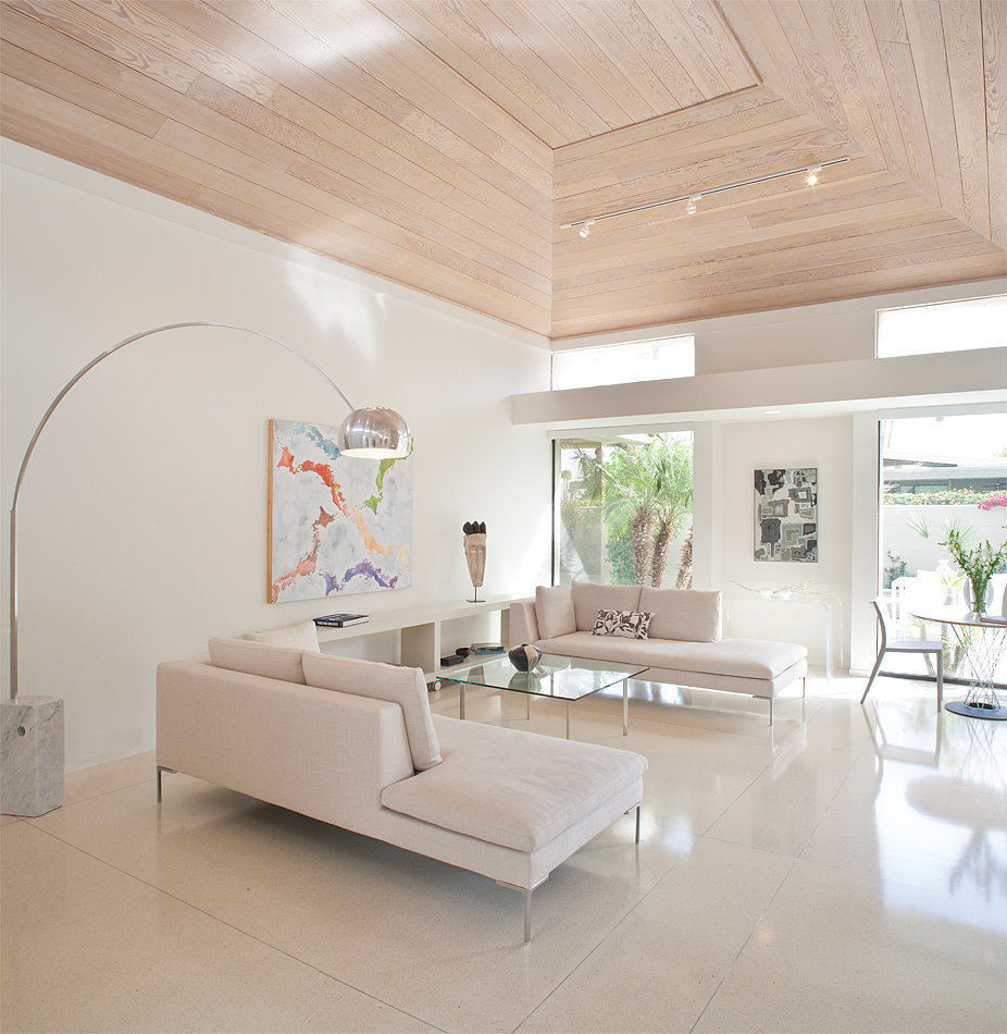 Natural light floods in through the home's windows, making the white interiors appear even brighter. Of course, the vaulted ceiling only intensifies the effect.   Photo by Tara Wujcik
