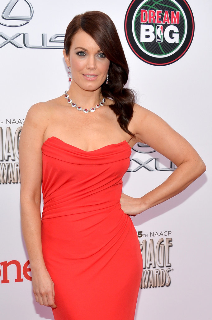 Bellamy Young donned a svelte orange dress.