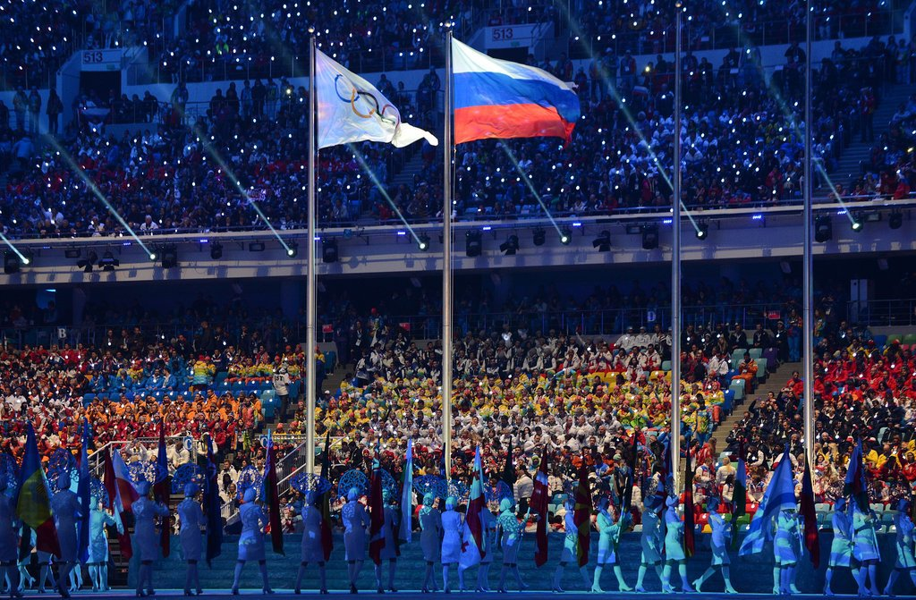 The Russian flag waved beside the Olympic flag.