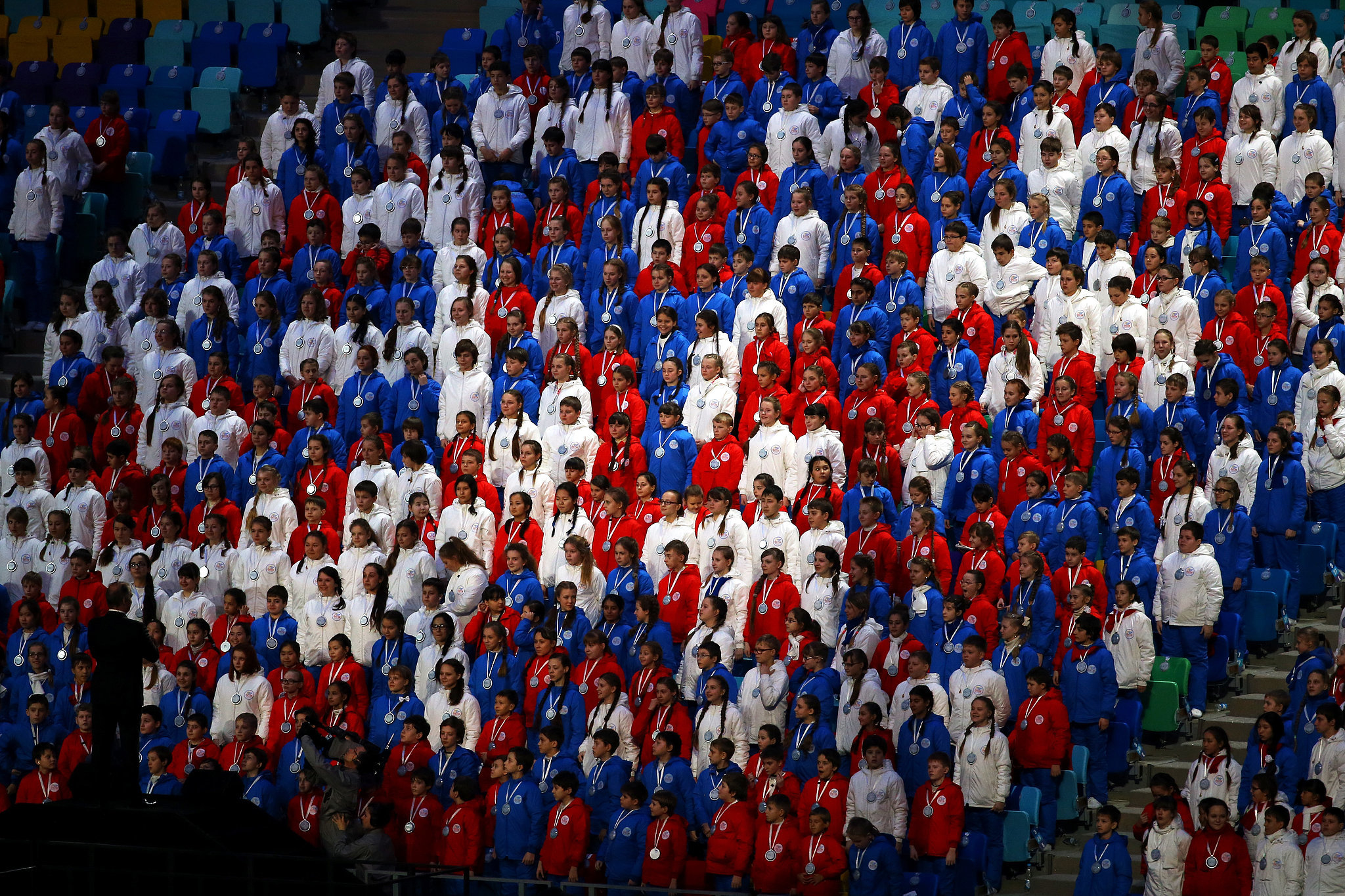 Children in red, white, and blue watched from the stands.