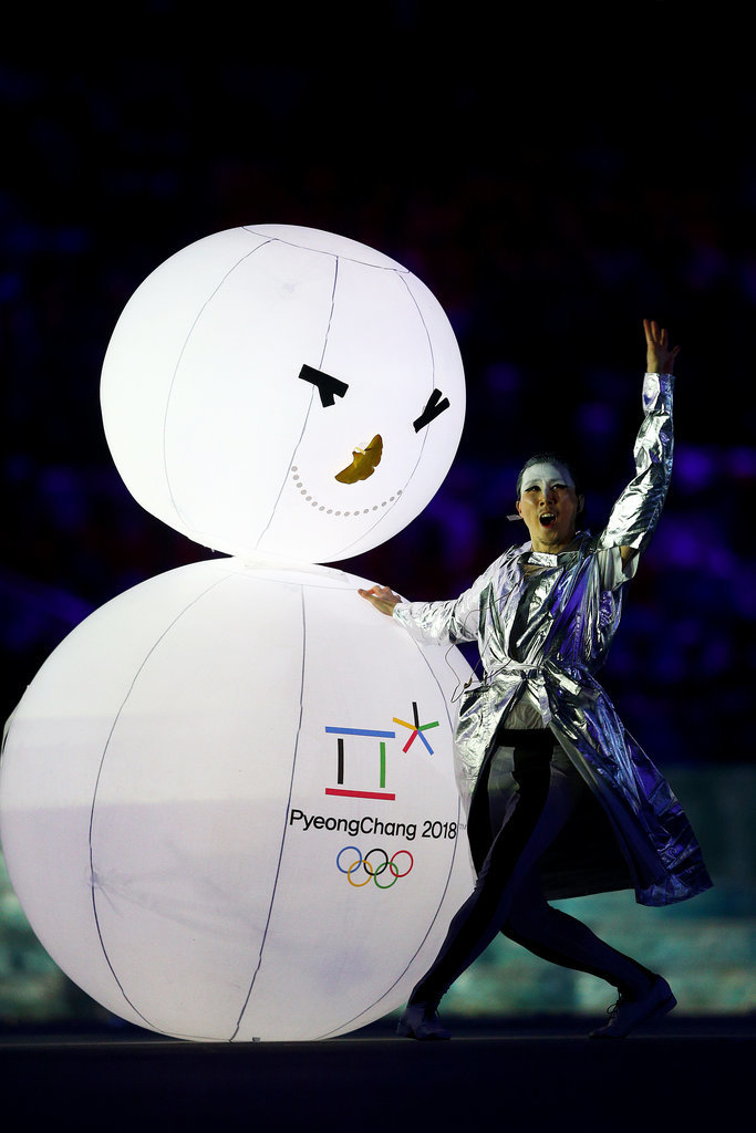 Dancers held on to snowmen with the Pyeongchang Olympic logo.