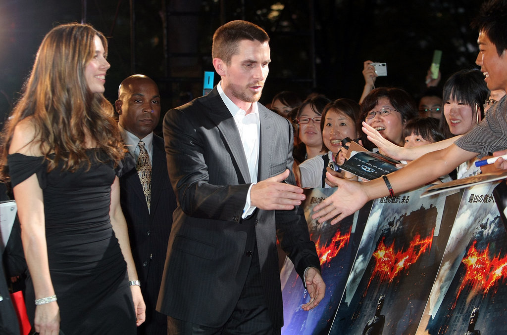 At the 2008 Tokyo premiere of The Dark Knight, Sibi walked the red carpet with Christian while he shook hands with fans.