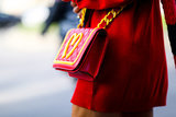 Anna Dello Russo was lovin' it — her Moschino crossbody bag, that is.