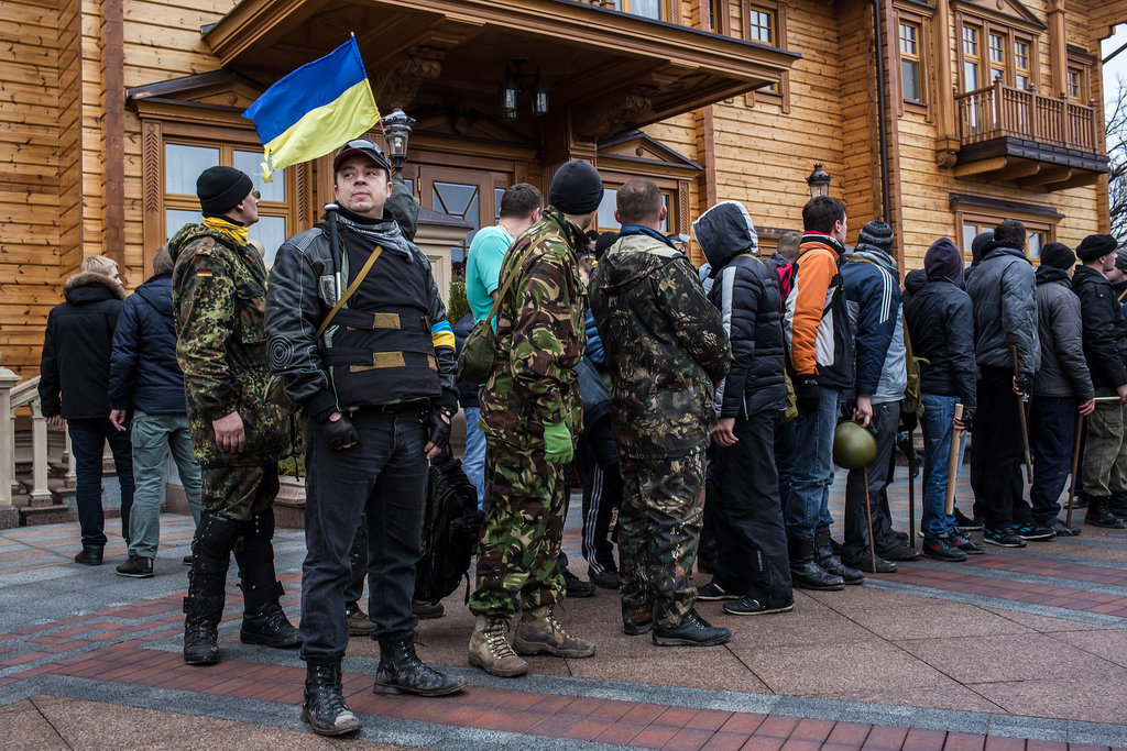 Members of the public lined up outside a house on the estate.