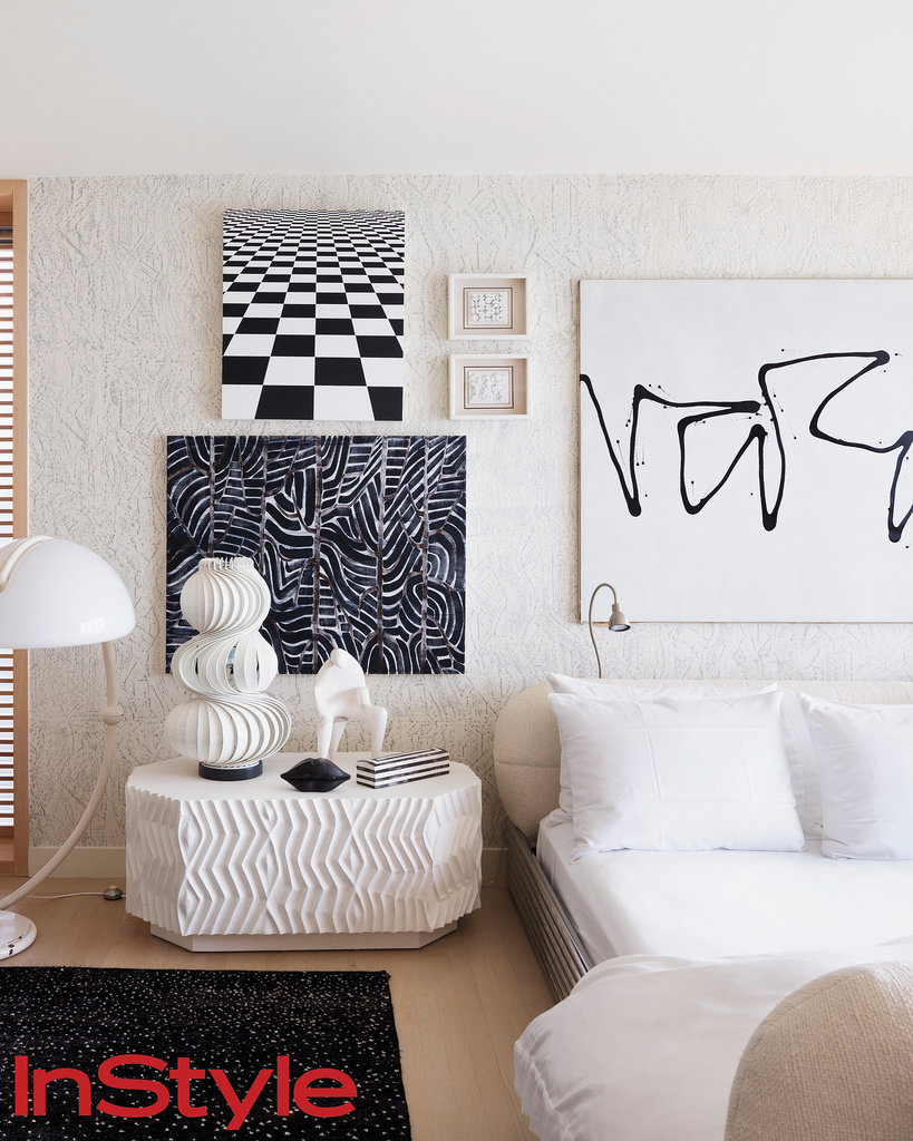 In line with Wearstler's over-the-top design style, her master bedroom has a bold, playful feel. Black and white is anything but boring with graffiti art and textured surfaces.  Photo by Dean Kaufman for InStyle