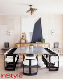 While the dining room has a grand stone table and modern chairs, the way that the artwork is displayed keeps the vibe casual. As for the chandelier, it resembles seaweed to fit with the home's oceanside location.  Photo by Dean Kaufman for InStyle