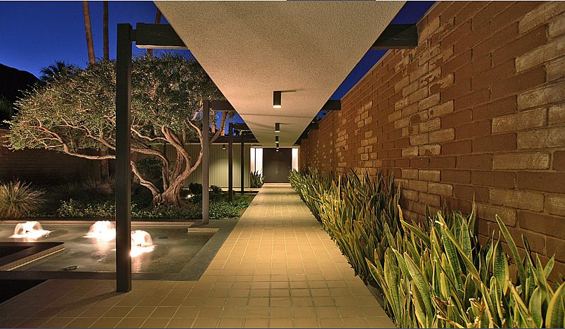 The dramatic entrance to the home is intensified with an illuminated water feature. Source: Capitas Real Estate