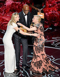 Naomi Watts and Samuel L. Jackson embraced Great Gatsby costume designer Catherine Martin.