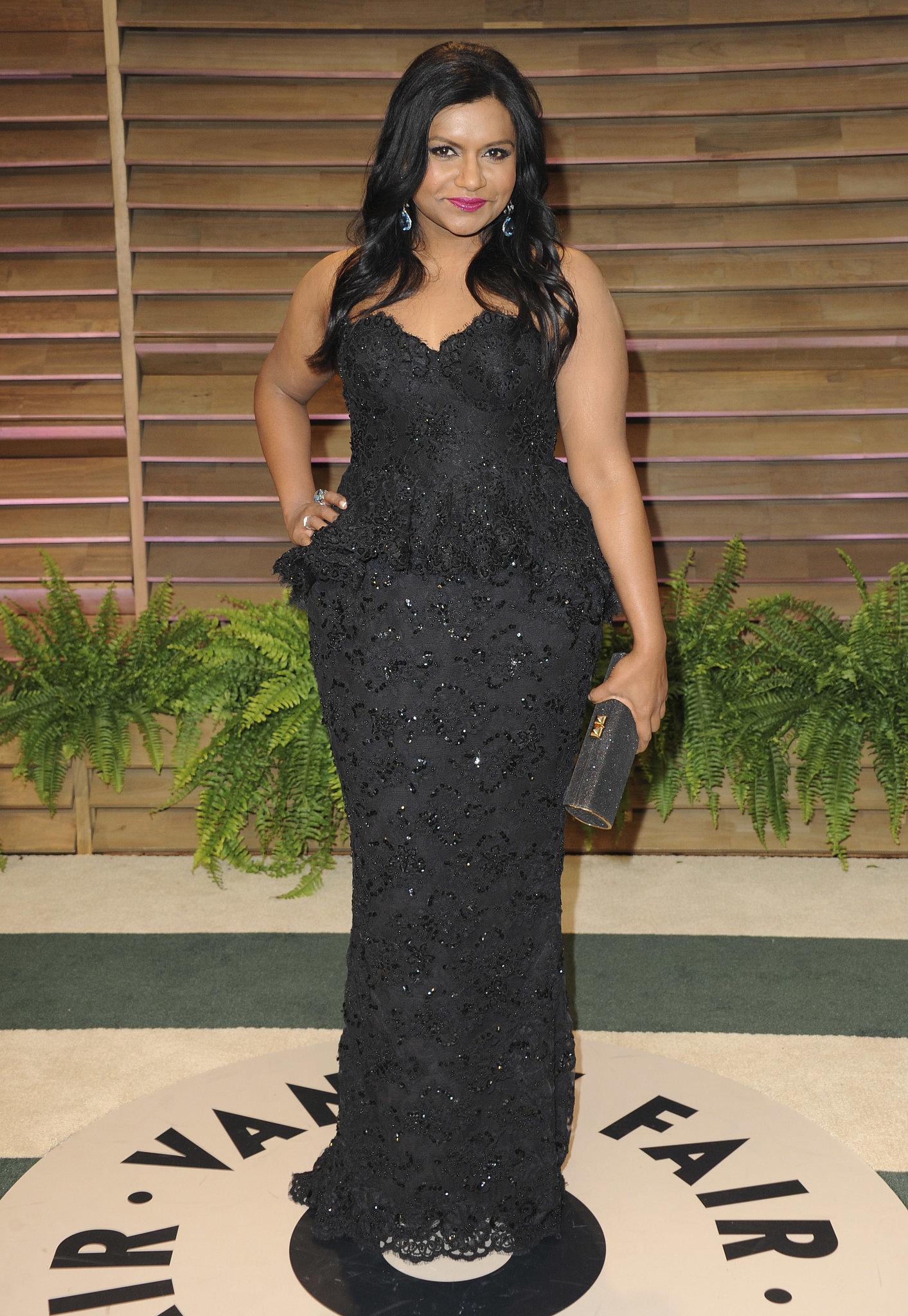 Mindy Kaling walked the carpet in a curve-hugging black dress.