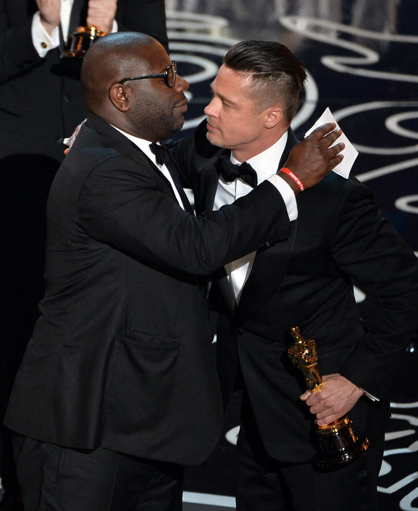 Brad Pitt hugged Steve McQueen after their best picture win.