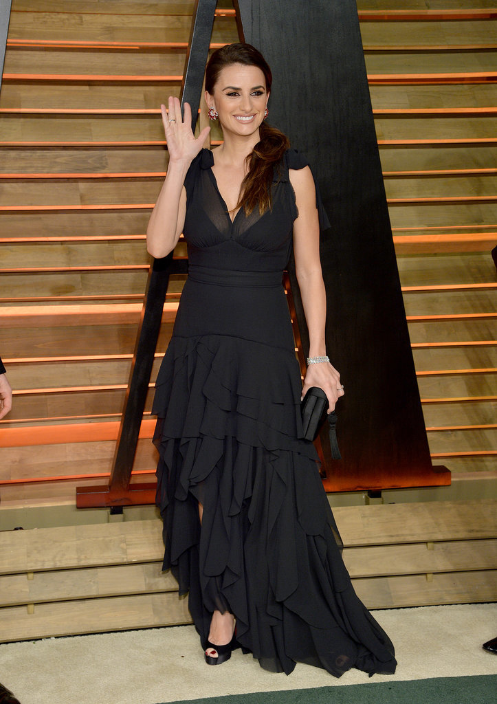 Penélope Cruz waved as she posed on the red carpet.
