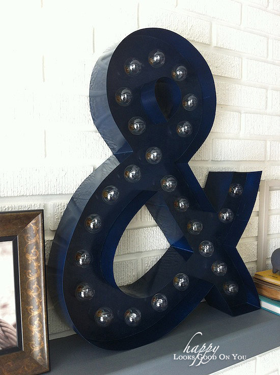 As fantastic as the ampersand looks all lit up, it's still pretty amazing without the lights on. The glossy sheen of the paint makes it appear like it's made of metal. Source: Happy Looks Good on You