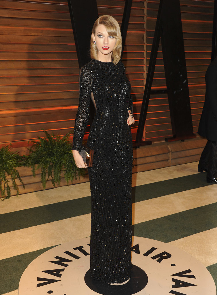 Taylor Swift wore bright red lipstick and a long black dress.